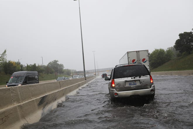 Flooding on M-10 Lodge Freeway in Detroit slows down traffic between Linwood and Livernois Avenue on the south and northbound lanes on Tuesday, Sept. 25, 2018.
