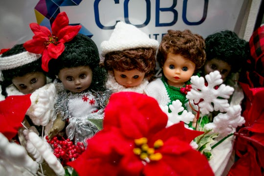 Gift dolls for Christmas are displayed at the  Detroit Goodfellows Annual Tribute Breakfast XXIX at Cobo Center in Detroit Tuesday.