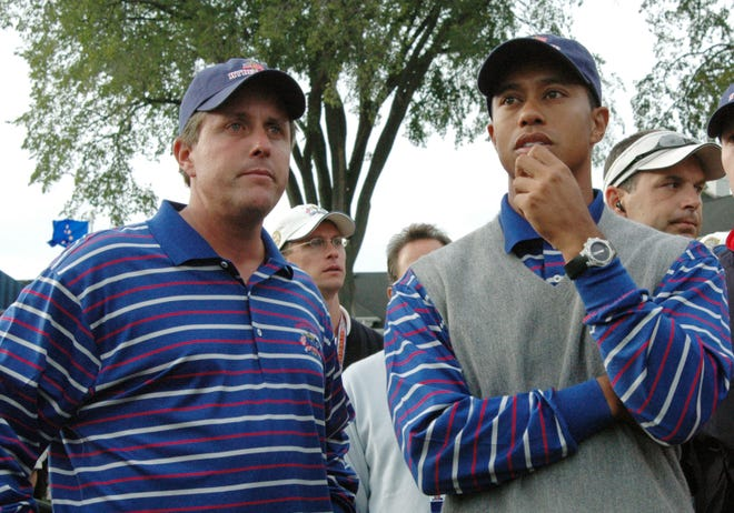 Phil Mickelson and Tiger Woods shown during the 2004 Ryder Cup at Oakland Hills Country Club.