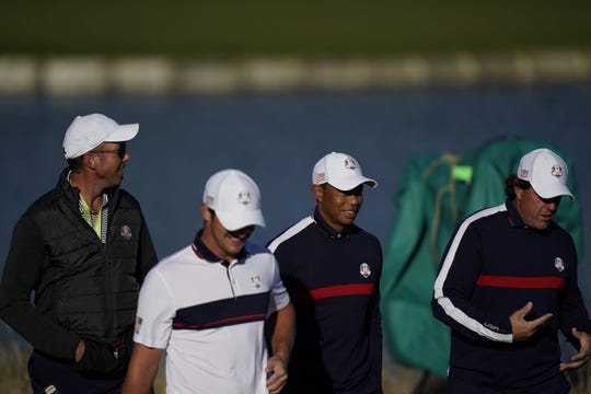 Tiger Woods and Phil Mickelson walk during a practice round at the Ryder Cup on Tuesday.