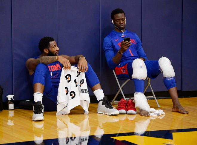 Andre Drummond, left, and Reggie Jackson relax at the end of practice.