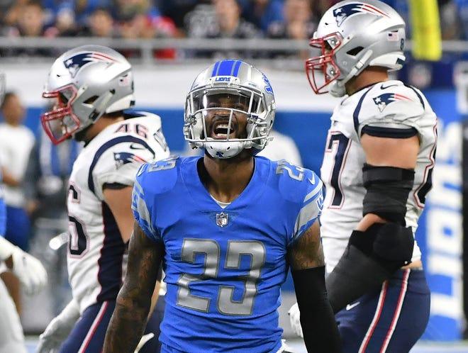 Lions cornerback Darius Slay celebrates after intercepting a Patriots quarterback Tom Brady pass in the fourth quarter.