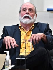 William Minore of Benzonia, Michigan,  gestures during testimony at his trial on carrying illegal stun guns on July 18, 2018, in Grand Traverse County Circuit Court.  The taser possession charges were the only ones left after all state and federal charges related to the bank robberies were dropped. He was convicted and sentenced to a $100 fine and time served.