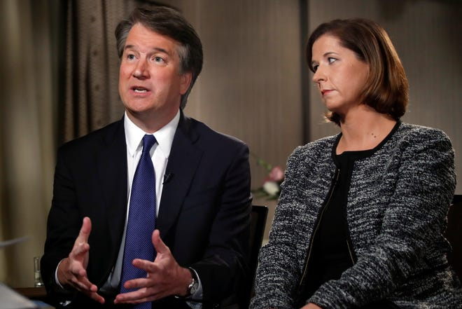 Brett Kavanaugh, with his wife Ashley Estes Kavanaugh, answers questions during a FOX News interview on Monday in Washington about allegations of sexual misconduct against the Supreme Court nominee.