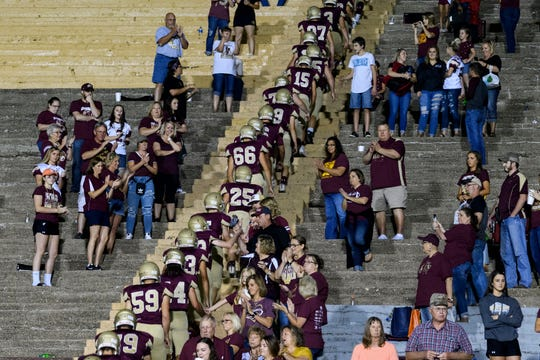 As they walk back to the locker room, the Mount Carmel Golden Aces receive applause for defeating the Washington Hatchets 61-20 during Homecoming in Mount Carmel, Ill., Friday, Sept. 21, 2018.