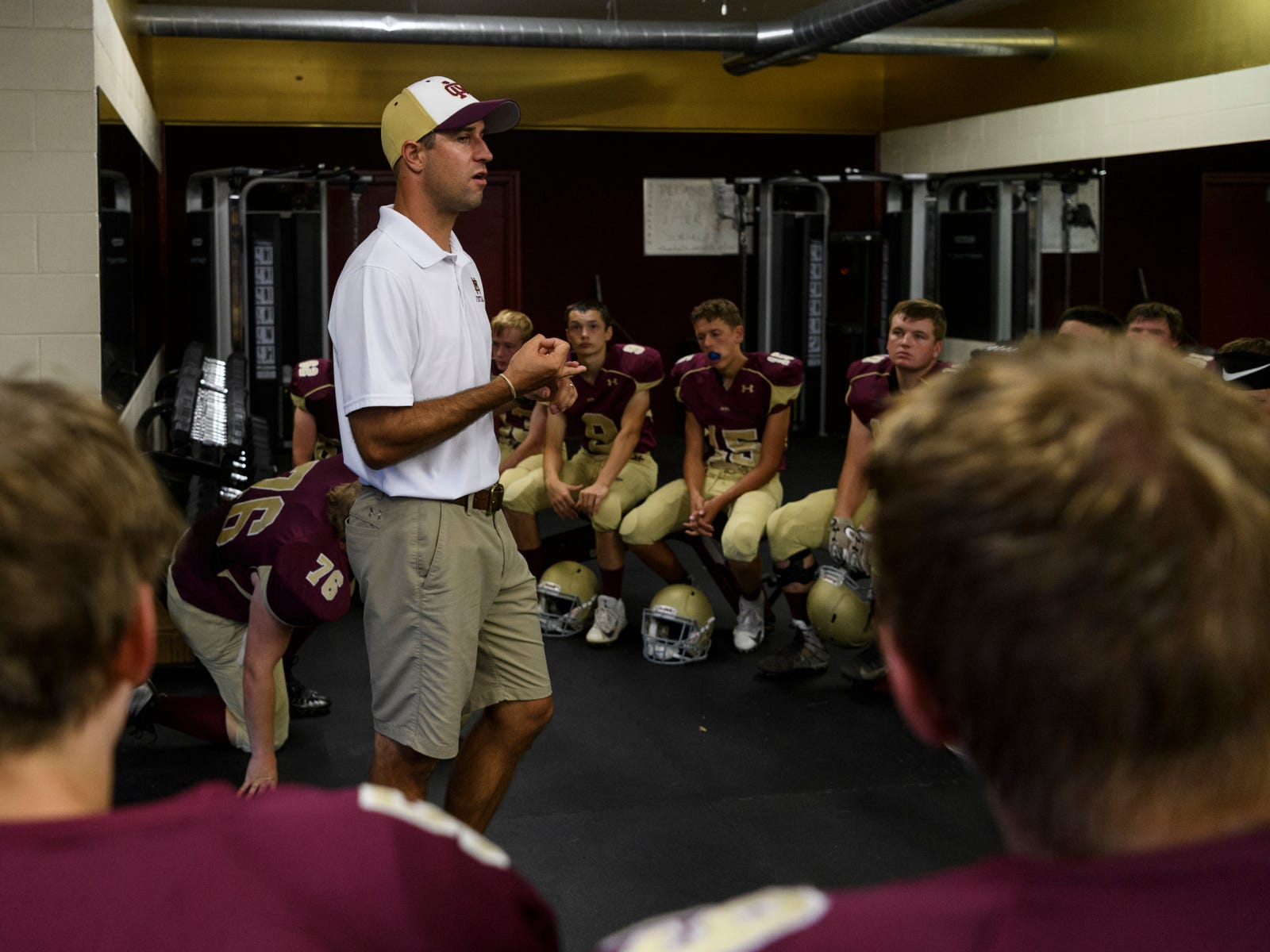 Mount Carmel Head Coach Michael Brewer preps his team in the locker room before taking on the Washington Hatchets at Riverview Stadium, known as the Snake Pit, in Mount Carmel, Ill., Friday, Sept. 21, 2018. The Golden Aces defeated the Hatchets 61-20.