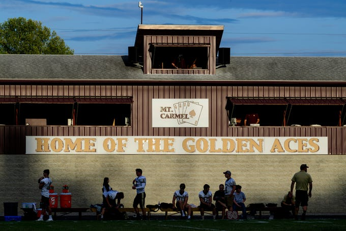 The sun sets on Riverview Stadium, known as the Snake Pit, before the Mount Carmel Golden Aces take on the Washington Hatchets in Mount Carmel, Ill., Friday, Sept. 21, 2018. The Golden Aces defeated the Hatchets 61-20.