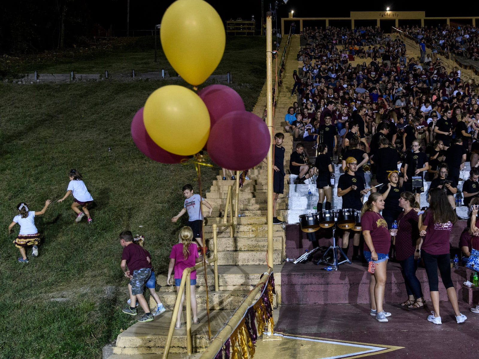 Riverview Stadium, known as the Snake Pit, is full of people during the Mount Carmel Golden Aces Homecoming game against the Washington Hatchets in Mount Carmel, Ill., Friday evening, Sept. 21, 2018. The Golden Aces defeated the Hatchets 61-20.