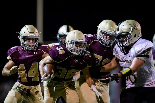 Satchel Patberg (38) and the Mount Carmel Golden Aces have a challenging road ahead, beginning Friday at Jasper.