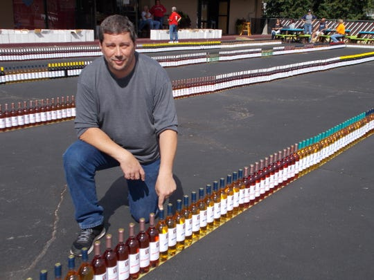 Mike Golembiowski and friends lined up 1,721 wine bottles to challenge the Guinness Book of World Records mark of 1,111 set in Chile in 2016.