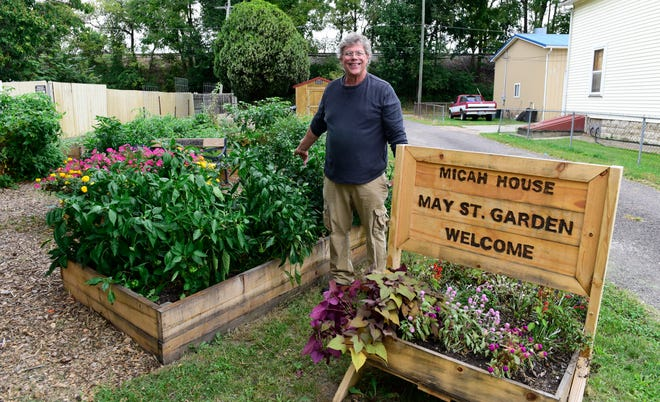 Roger Hart of Micah House grows a community garden on May Street in Fremont to feed healthy vegetables to neighborhood residents for free.