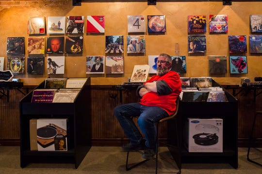 Owner and operator Mike Fogerty poses for a portrait on Tuesday, Sept. 25, 2018, at All Sales Vinyl in Old Town Fort Collins, Colo.