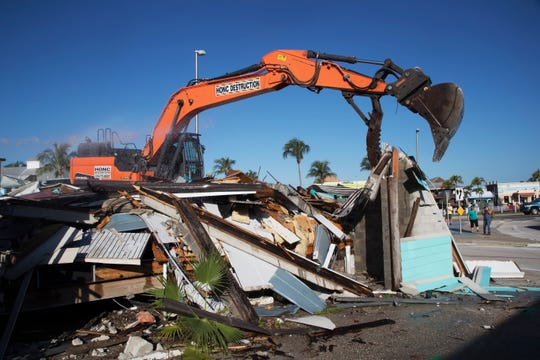 The building that housed Ocean Jewels and briefly the Fort Myers Beach Chamber of Commerce at the base of the Matanzas Bridge on Fort Myers Beach was torn down on Tuesday morning 9/25/2018. It marks a milestone in the construction of the Margaritaville Resorts being built by TPI Hospitality. This property will be donated to the town of Fort Myers Beach as part of an agreement with TPI. A lawsuit filed by a town resident could delay the construction of the resort.