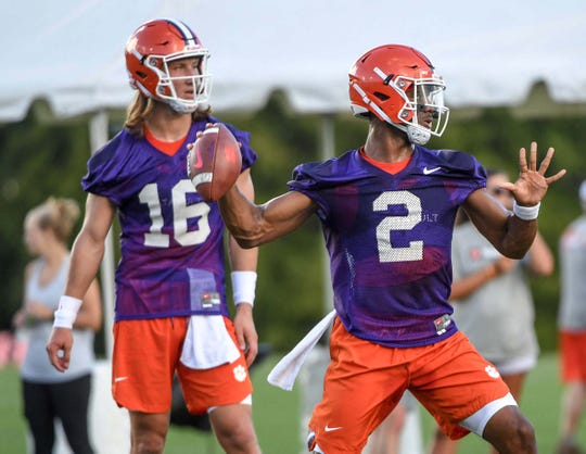 Clemson quarterback Kelly Bryant (2) throws near quarterback Trevor Lawrence (16) during the first day of practice at the Clemson Indoor Football facility at Clemson on Friday, August 3, 2018.