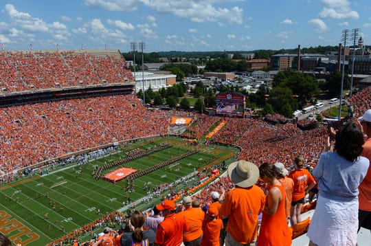 Clemson football fans pack the stadium, purchasing tickets, parking, food, and beverages at Memorial Stadium in Clemson in September.