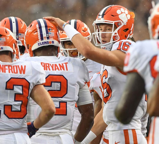 Clemson quarterback Trevor Lawrence (16) congratulates quarterback Kelly Bryant (2) after he scored against Texas A&M during the 1st quarter at Texas A&M's Kyle Field in College Station, TX Saturday, September 8, 2018.