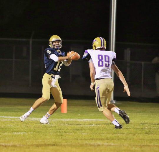Dillon quarterback Justus Peterson looks for a receiver.
