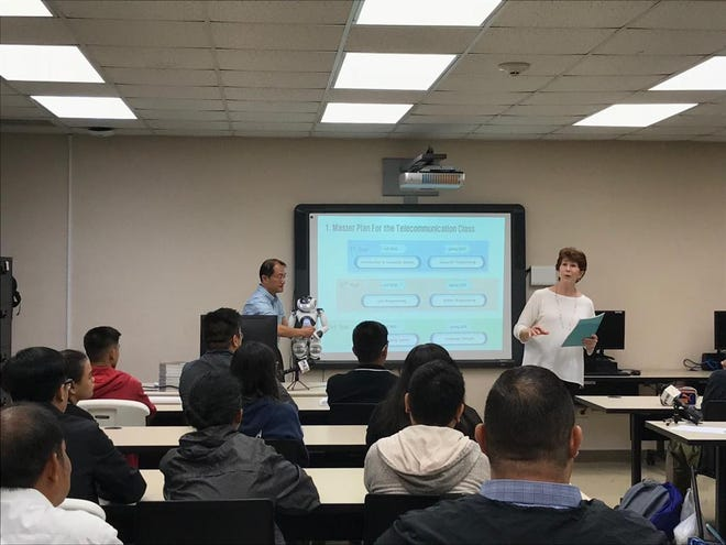 Guam Community College spokeswoman Jayne Flores, right, introduces a new three-year telecommunications program that streamlines student transition into higher education.