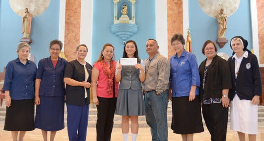 The Mercy Action Marianas, Limited recently presented the annual Catherine McAuley Scholarship to Erin Pangelinan, a Junior at the Academy of Our Lady of Guam. MAML, a sponsored ministry of the Sisters of Mercy, exists to support the works of Mercy that will foster human dignity, help finance the education of students seeking a Catholic education and provide for the quality of life of the aging and infirmed Sisters of Mercy.  Pictured left to right:  Srs. Mary Brigid Perez, Marian Therese Arroyo (Administrator, Sisters of Mercy of the Americas, South Central Community-Guam Region), Orlean Pereda, Helen Pangelinan, Erin Pangelinan, Aaron Pangelinan, Sr. Mary Angela Perez (AOLG President), Mary A.T. Meeks (AOLG principal), and Sr. Dorothy Lettiere.