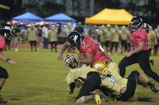 Southern High running back Noah Rosalin fights for yardage in the second half in the Dolphins' 18-0 win over the Tiyan Titans Sept. 24 at the GW field in Mangilao.