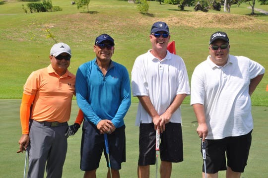 From left: Calvin Fernandez (Bank of Hawaii), Errol Allegre (operations manager, Quality Distributors), Mike Fleissner (general manager, Kmart) and Landon Nadler (general manager, Quality Distributors).