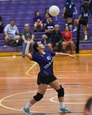 Academy's Cassidy Tobiason serves against the George Washington Geckos during an IIAAG High School Girls' Volleyball game at the GW High School gym on Sept. 25, 2018. The Cougars beat the Geckos in straight sets 25-18, 25-18.