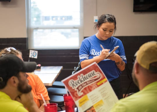 Sarah Renfrow takes lunch orders during the grand opening of Rockhouse on the River Tuesday, Sept. 25, 2018.