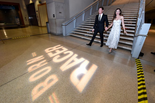"Scott Dixon and his wife, Emma Davies-Dixon, arrive at the ""Born Racer"" world premiere Monday at the IMAX theater at the Indiana State Museum."