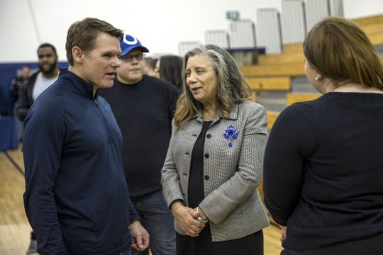 Colts general manager Chris Ballard greets Mary Jackson, mother of late player Edwin Jackson, after a vigil remembering Jackson and Uber driver Jeffrey Monroe back in February. Eight months later, Ballard remains in touch with the family.