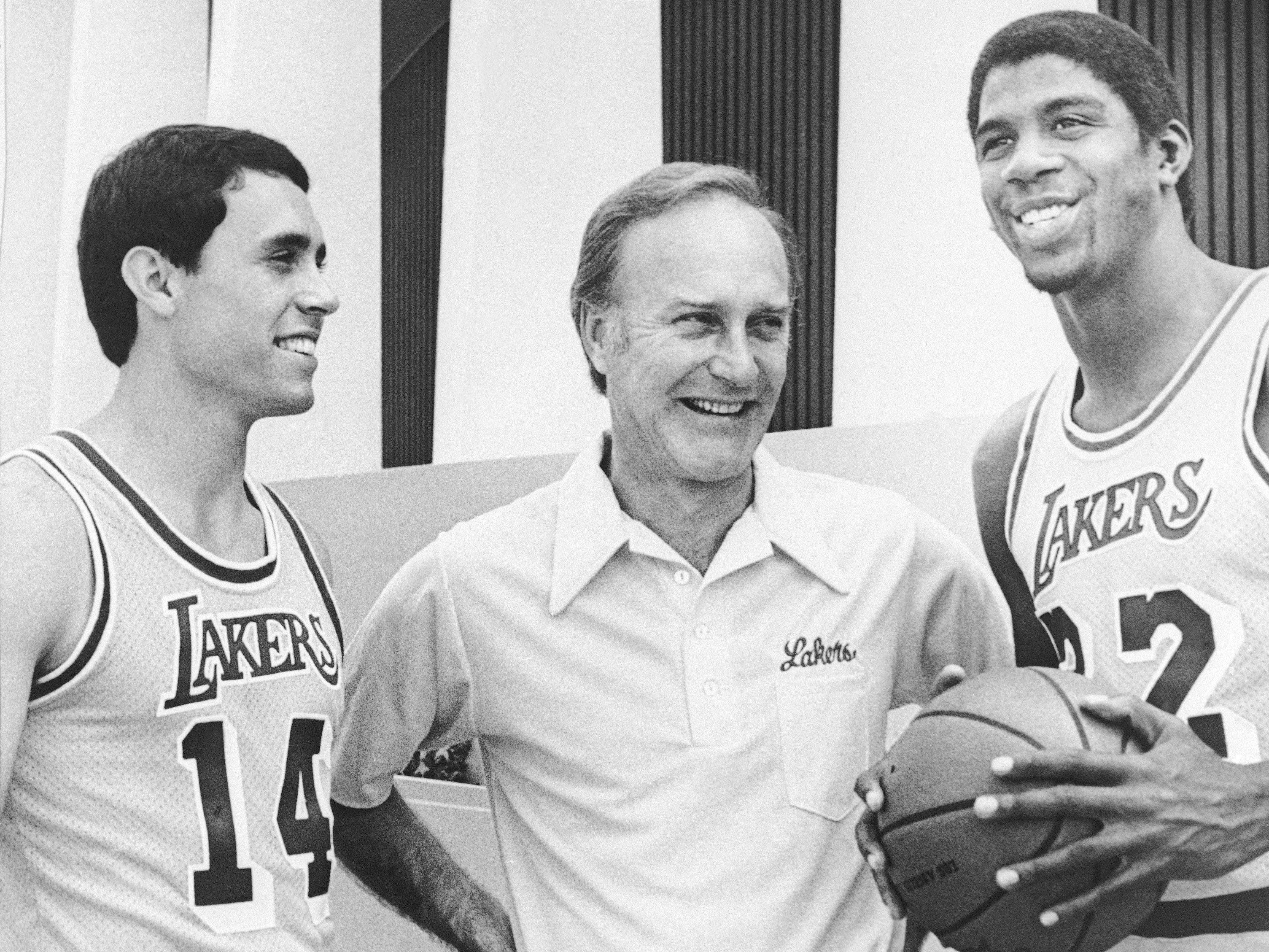 "These three new faces from left Brad Holland, of University of California at Los Angeles; head coach Jack McKinney, former assistant at Milwaukee; and Earvin ""Magic"" Johnson, of Michigan State; were on hand when the Los Angeles Lakers opened their 1979-80 season with picture day, Sept. 14, 1979 in Los Angeles. Johnson was the first player selected in the NBA draft this year, the first time in 19 years the Lakers have had first pick. (AP Photo/Nick Ut)"