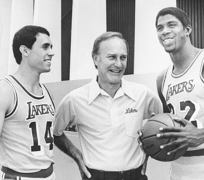 """Coach Jack McKinney, center, stood with Brad Holland and Earvin """"Magic"""" Johnson on Lakers' picture day Sept. 14, 1979, in Los Angeles."""