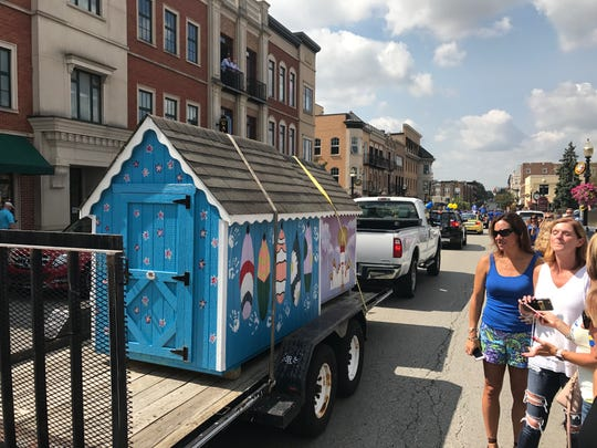 Carmel High School students from each grade build a playhouse and these are displayed during the homecoming parade and auctioned with proceeds benefiting the Carmel Education Foundation