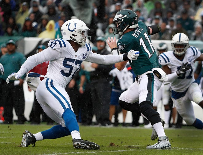 Indianapolis Colts defensive end Kemoko Turay (57) chases after Philadelphia Eagles quarterback Carson Wentz (11) during their game at Lincoln Financial Field in Philadelphia, PA. on Sunday, Sept. 23, 2018.