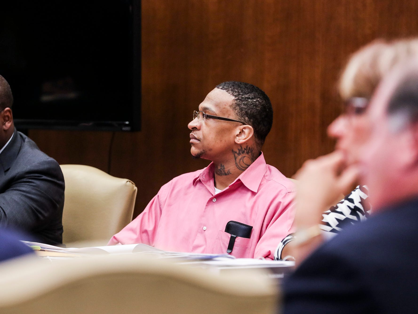 Quinton Tellis, right, is seen on the first day of his retrial in Batesville, Miss., Tuesday, Sept. 25 2018. Tellis is charged with burning 19-year-old Jessica Chambers to death almost three years ago on Dec. 6, 2014. Tellis has pleaded not guilty to the murder. (Brad Vest/The Commercial Appeal via AP, Pool)