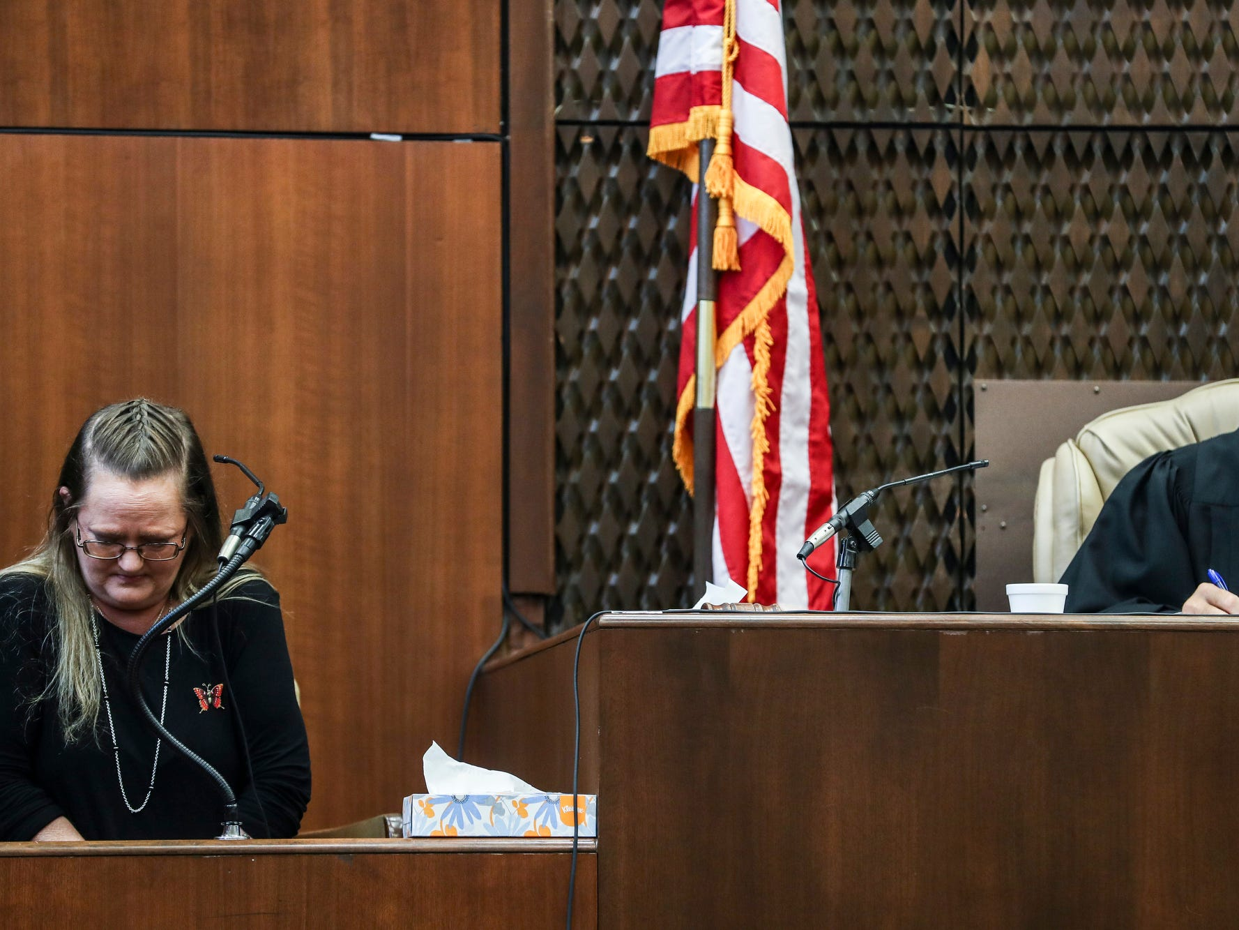 Lisa Chambers, left, Jessica Chambers mother, is seen on the stand during the first day of the retrial of Quinton Tellis in Batesville, Miss., Tuesday, Sept. 25 2018. Tellis is charged with burning 19-year-old Jessica Chambers to death almost three years ago on Dec. 6, 2014. Tellis has pleaded not guilty to the murder.