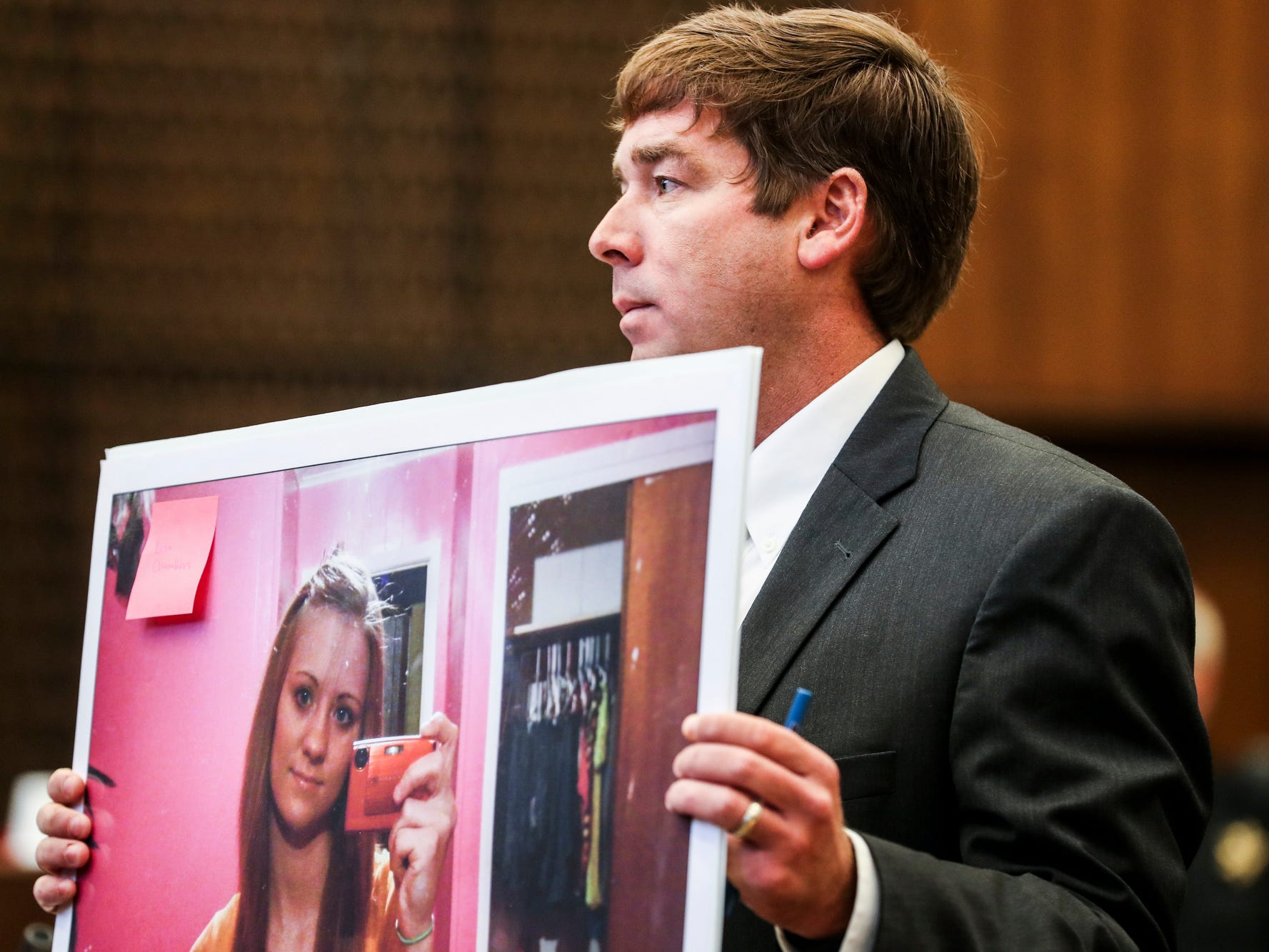 Deputy Prosecutor Jay Hale holds up a picture of Jessica Chambers on the first day of the retrial of Quinton Tellis in Batesville, Miss., Tuesday, Sept. 25 2018. Tellis is charged with burning 19-year-old Jessica Chambers to death almost three years ago on Dec. 6, 2014. Tellis has pleaded not guilty to the murder.