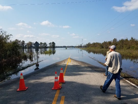 Shown in this photo George Dawson took in North Carolina are one of the many roads the team ran into that were flooded over. In the distance on the right side of the road what resembles a speck is a semi truck carrying generators that had been stopped in flood waters. (George Dawson / Courtesy)
