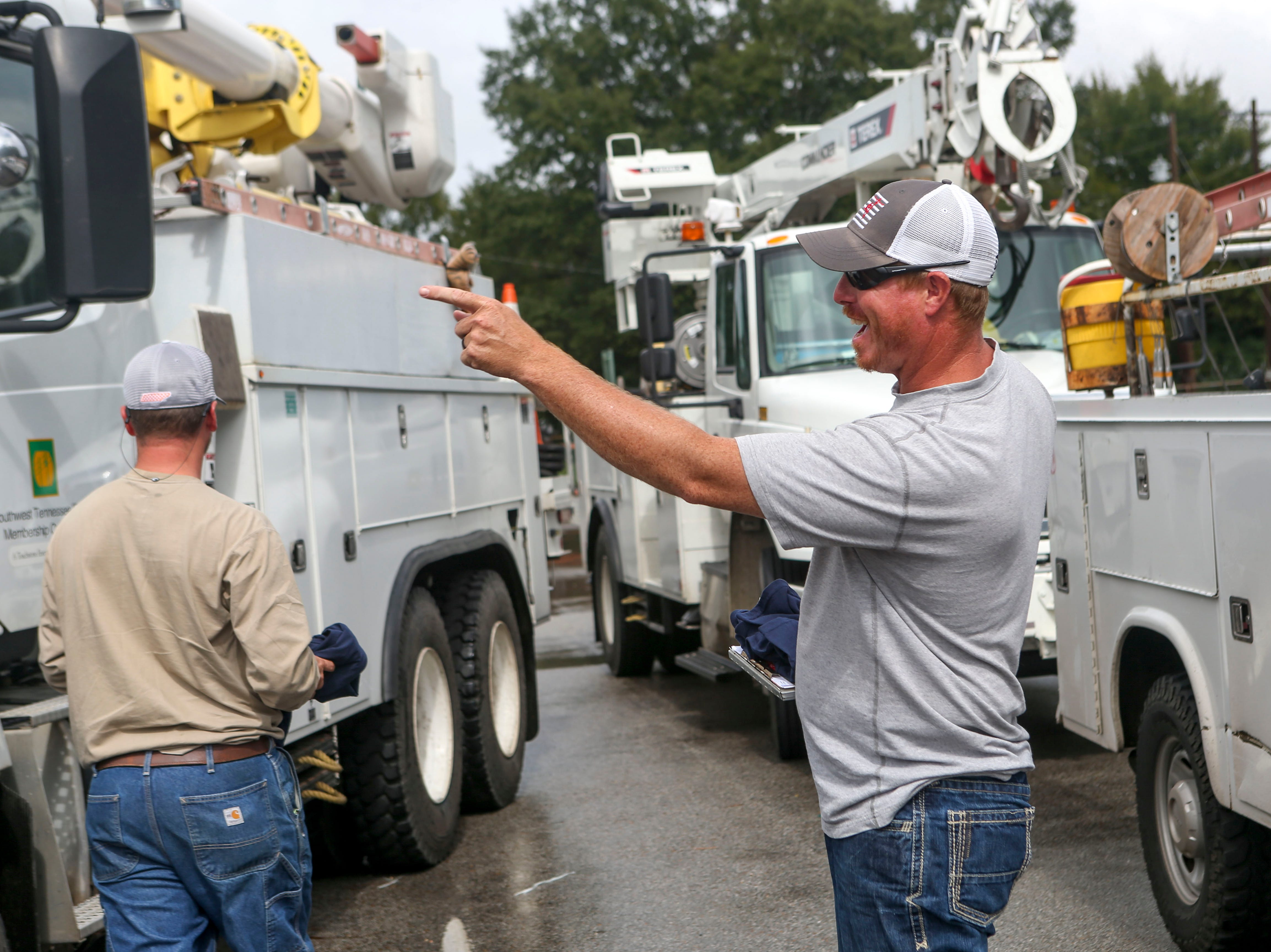 Linemen that just returned from recovery efforts in North Carolina joke around after parking the trucks and meeting with their managers at Southwest Tennessee Electric in Jackson, Tenn., Monday, Sept. 24, 2018.