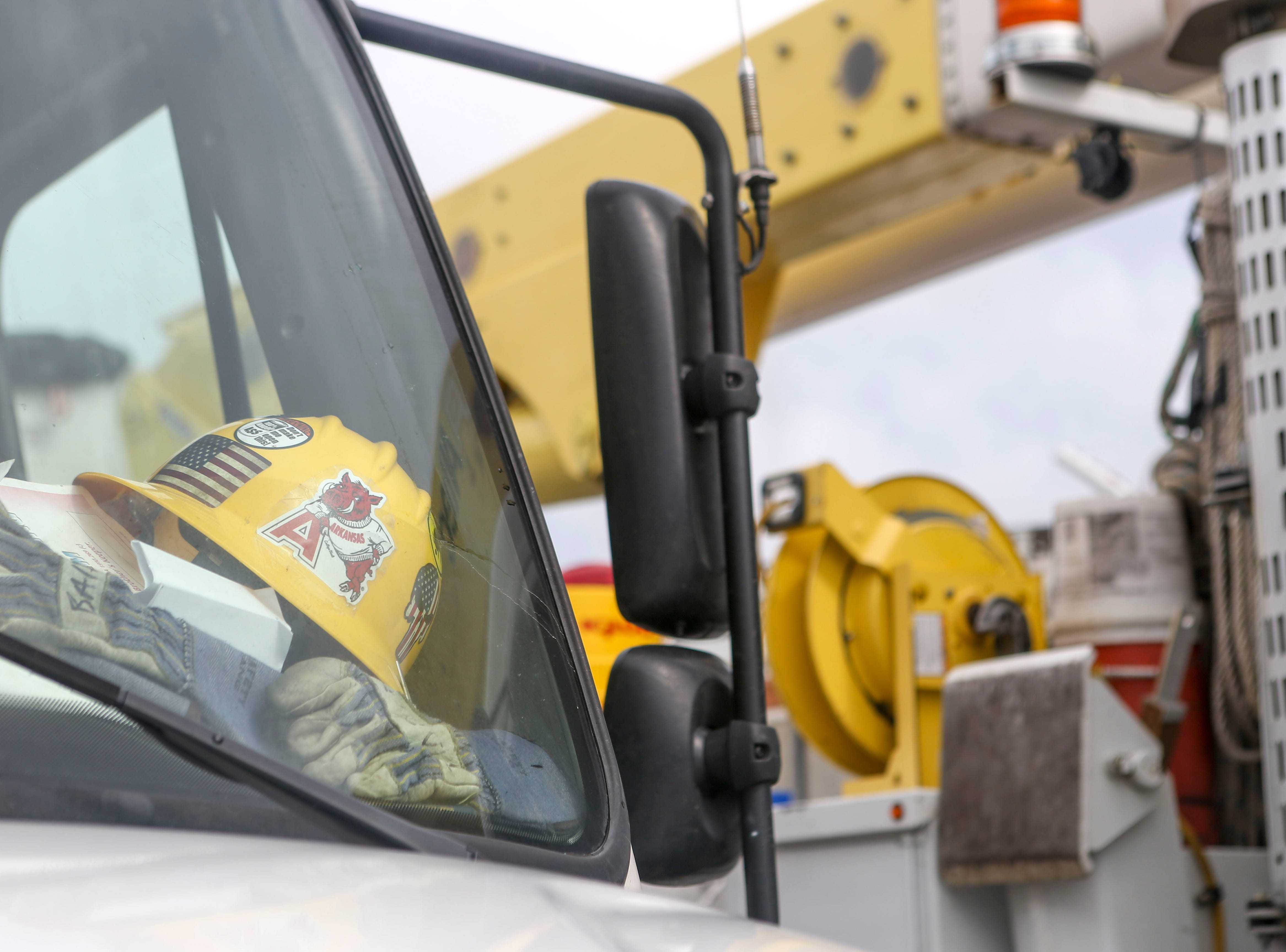 A helmet and equipment belonging to linemen assisting with Hurricane Florence recovery efforts rest on the dashboard of a work truck having just pulled up at Southwest Tennessee Electric in Jackson, Tenn., Monday, Sept. 24, 2018.