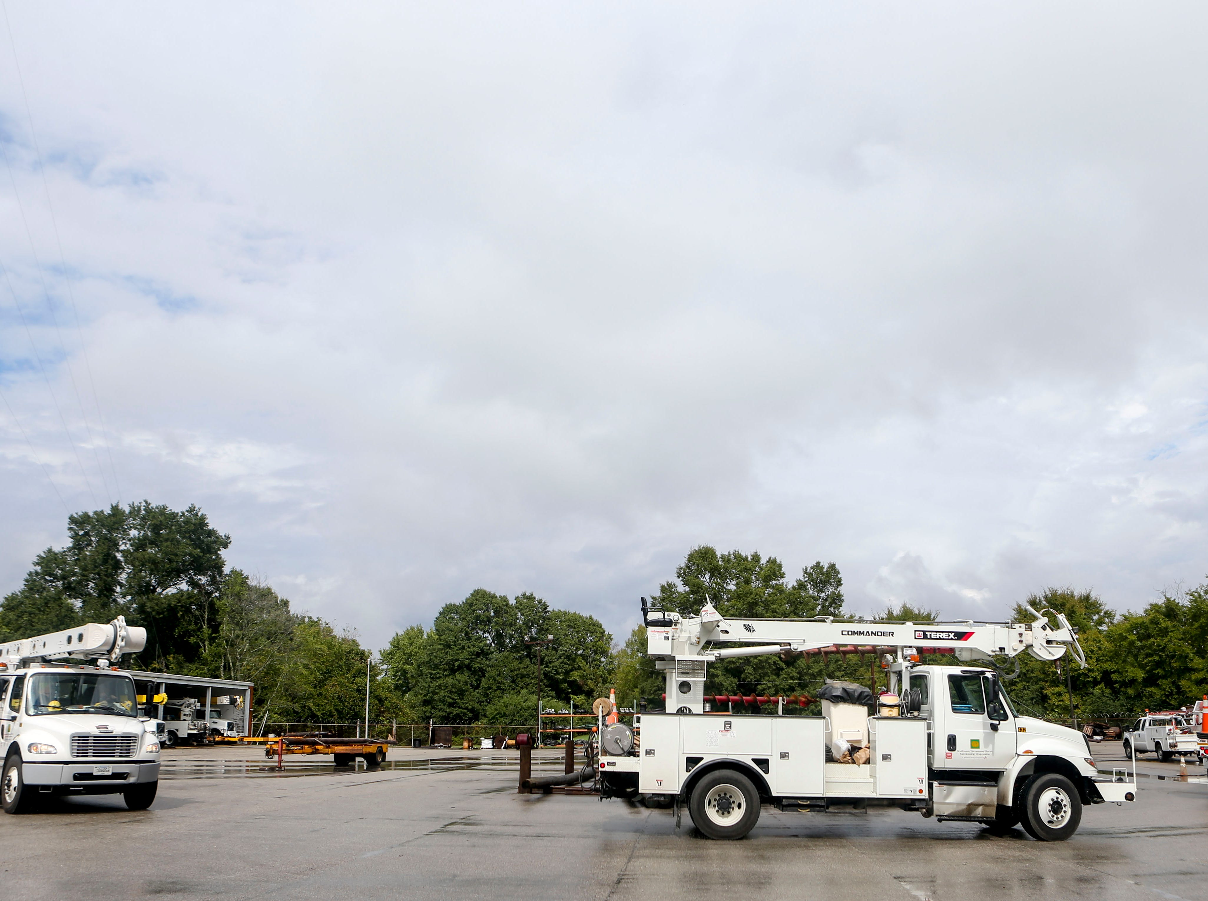 Linemen pull in to the truck yard after having been dispatched to areas affected by Hurricane Florence in North Carolina at Southwest Tennessee Electric in Jackson, Tenn., Monday, Sept. 24, 2018.