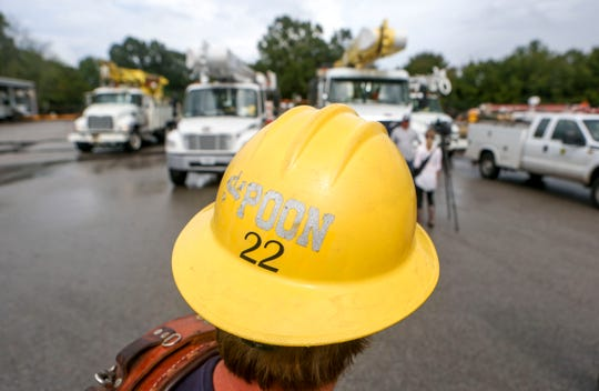 """Drew """"Spoon"""" Yancey watches on as one of his fellow linemen is interviewed after returning from Hurricane Florence recovery efforts at Southwest Tennessee Electric in Jackson, Tenn., Monday, Sept. 24, 2018."""