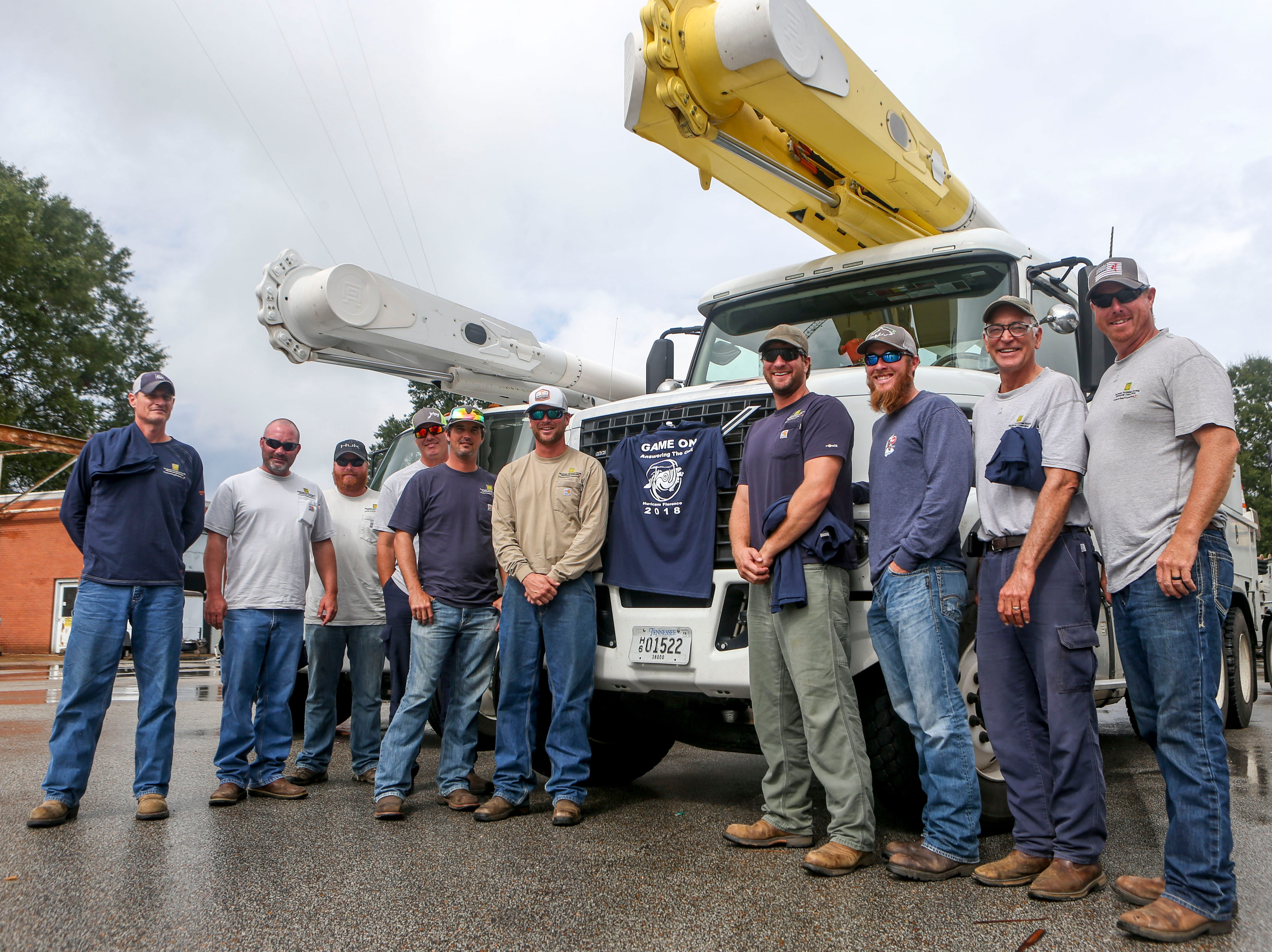 The team of linemen that was dispatched to assist with recovery efforts following Hurricane Florence stand in front of work trucks at Southwest Tennessee Electric in Jackson, Tenn., Monday, Sept. 24, 2018.