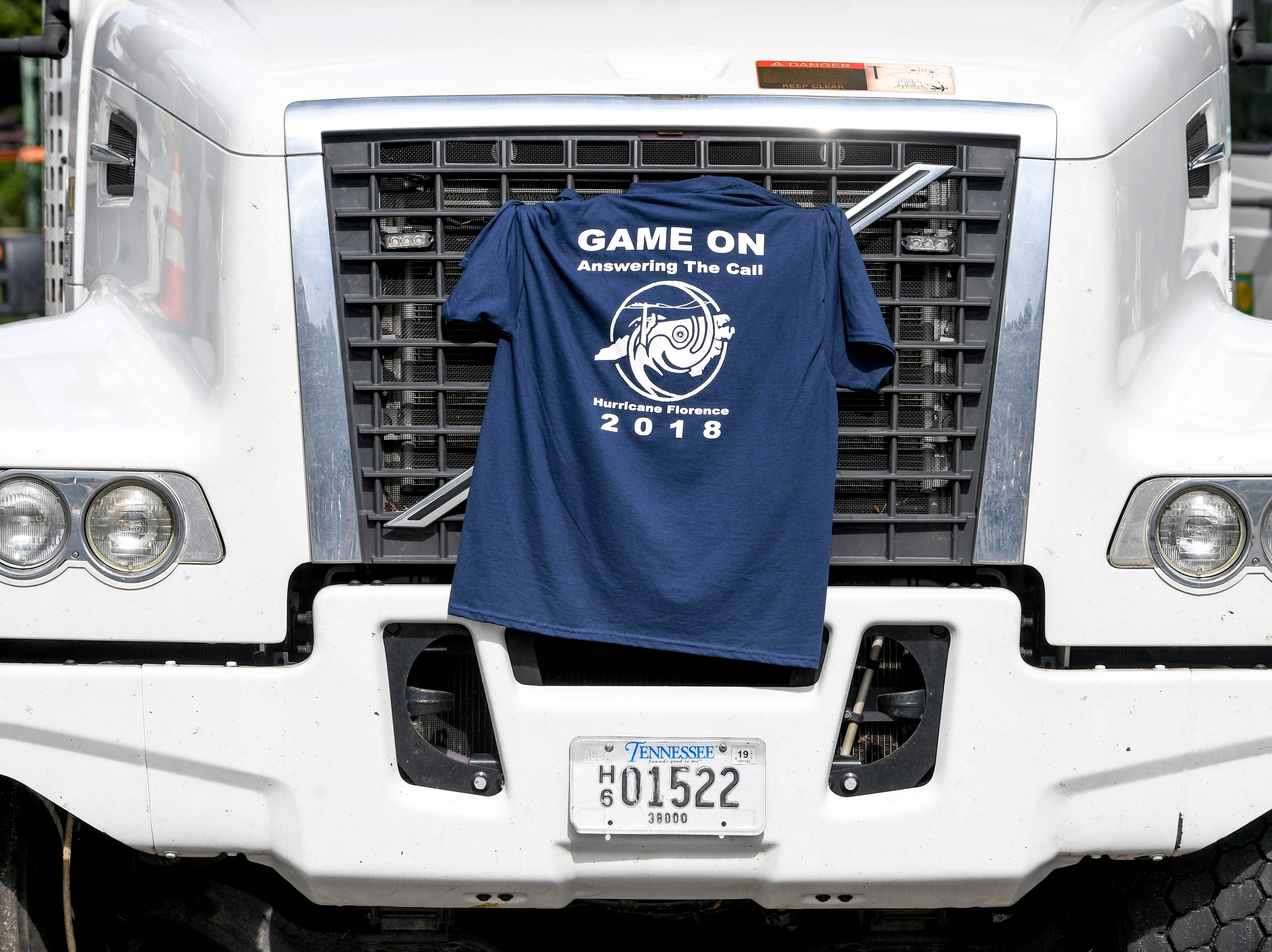 A t-shirt made for the team of linemen that were dispatched to areas affected by hurricane Florence is tucked into the grill of a work truck at Southwest Tennessee Electric in Jackson, Tenn., Monday, Sept. 24, 2018.