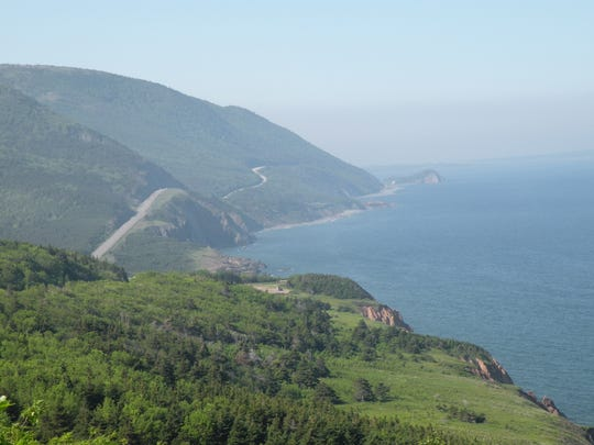 The Cabot Trail, a 185-mile loop on Cape Breton Island, Nova Scotia, winds through forested mountains and connects coastal communities with Acadian, Irish and Scottish heritage. The route is often ranked as one of the most scenic highways in the world.