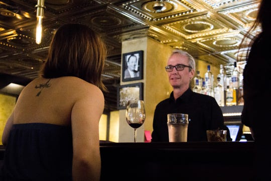 Bartender Ian Roach serves a patron at The Corner Lounge on opening day Sept. 25, 2018.