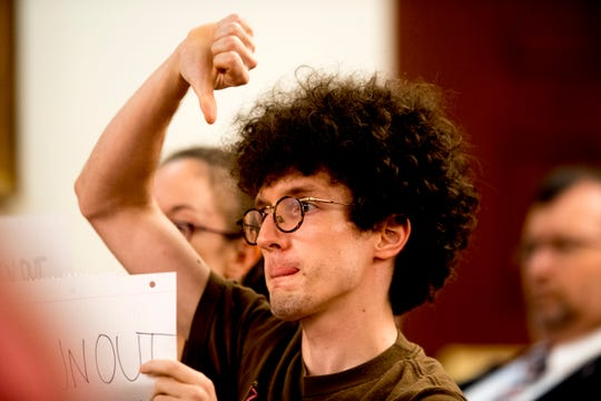 A protester at the University of Tennessee Board of Trustees meeting indicates his disapproval at the UTK Visitor's Center in Knoxville, Tennessee on Tuesday, September 25, 2018. The board met to discuss several topics including the installment of Randy Boyd as interim president.