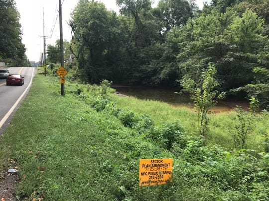 The pond for which Pond Gap is named is on the edge of a potential 110-unit apartment site.