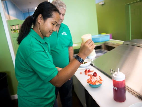 Penny King prepares Sno Cream, her and her husband Bill's taken on the Korean ice treat bingsu, at their shop, Sno Cream, in Turkey Creek on Tuesday, September 25, 2018.