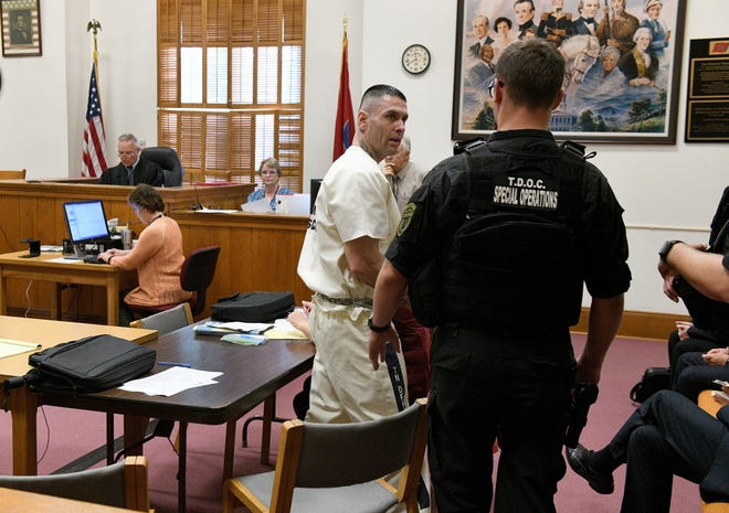 Robert Fusco is taken out of Morgan County Criminal Court under heavy security Tuesday, September 25, 2018 after an indictment charging him and others with escape and other crimes at the Morgan County Correctional Complex.