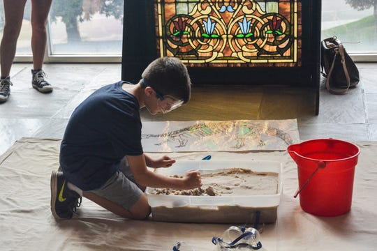 """The McClung Museum's Family Fun Day """"Can You Dig It?"""" includes children's activities that really involve digging."""